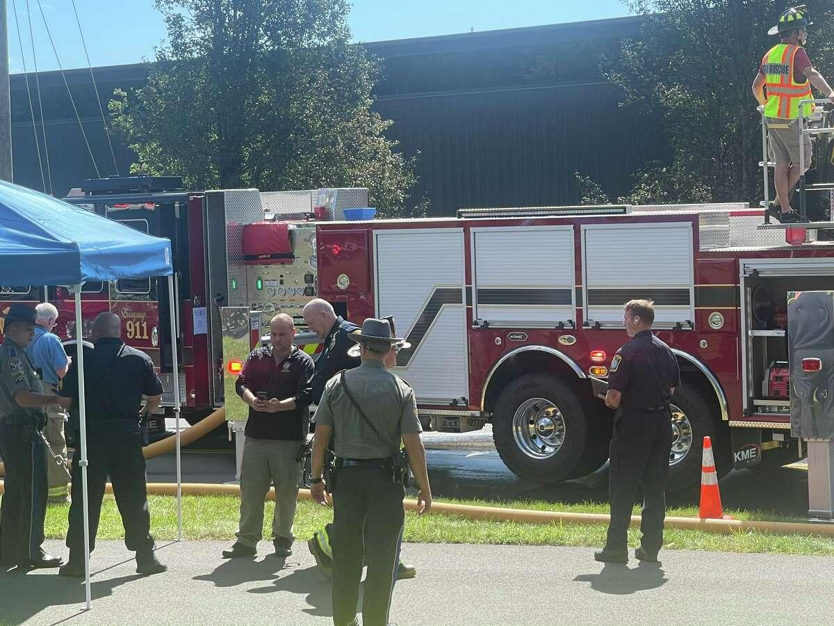 Farmington police Chief Melanson, right, and Captain Ryan, left, at the scene of the plane crash in Farmington.