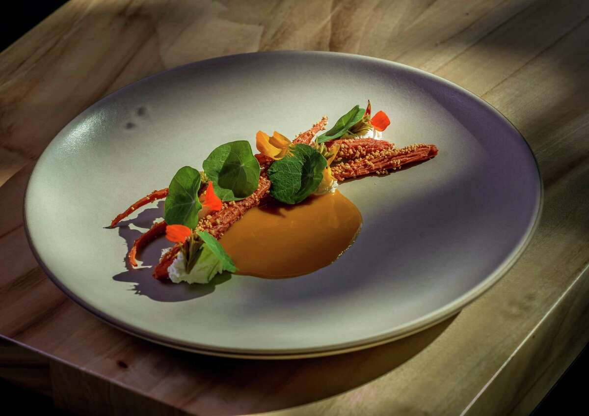 Carrot, sour curd and pickled pine, a dish by chef Matt Orlando of Copenhagen's Amass, served at In Situ in 2016.