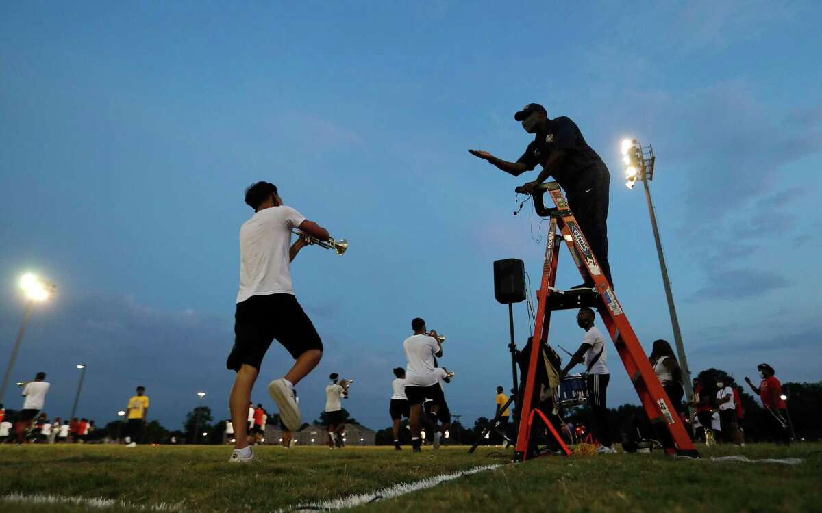 Prairie View A&M University's marching band director Dr. Timmey Zachery leads practice on the field from a ladder, Thursday, August 26, 2021, in Prairie View.