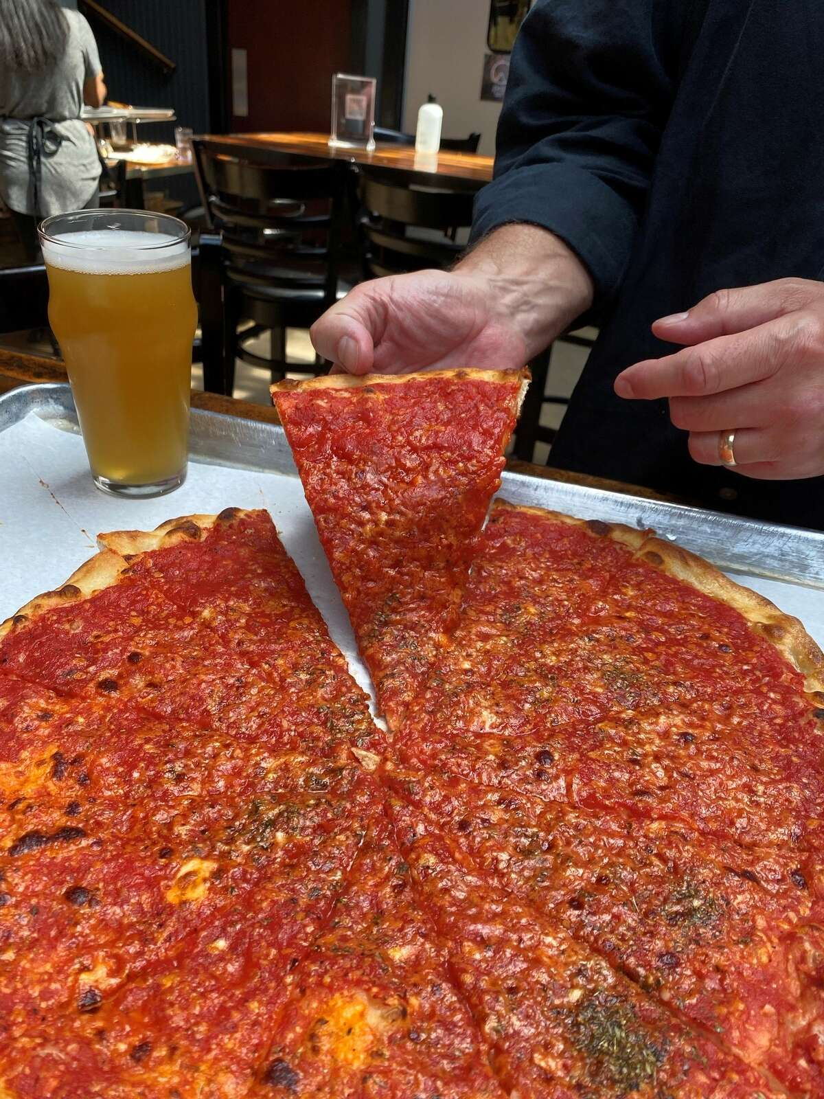 Piece Pizza in Chicago opened in 2001 and makes New Haven-style apizza.