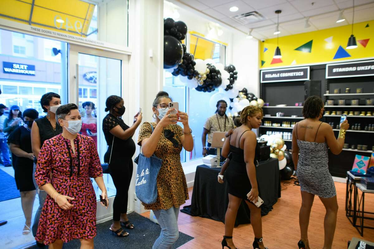 Guests enter after the ribbon cutting for BLCK Market in Pearland Town Center on Wednesday, Sept. 1, 2021.
