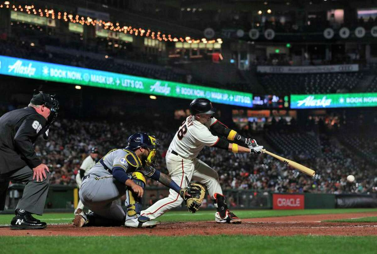 Buster Posey (28) hits a ball down the line that scored Krys Bryant (23) in the fifth inning as the San Francisco Giants played the Milwaukee Brewers at Oracle Park in San Francisco, Calif., on Wednesday, September 1, 2021.