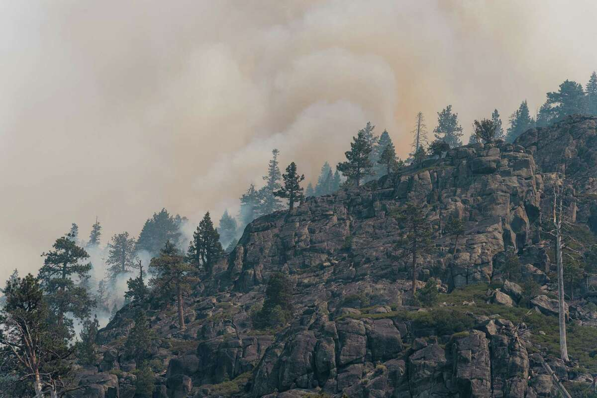 The Caldor Fire flares up Wednesday along Christmas Valley Road near South Lake Tahoe.