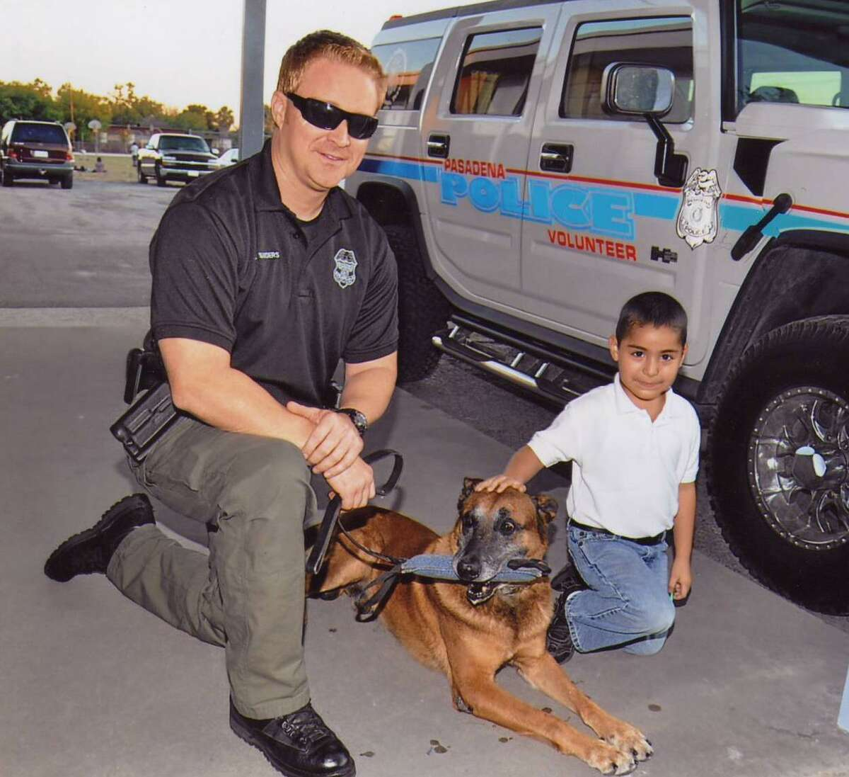 National Night Out is a longtime tradition in Pasadena. This year's event is set for Oct. 5. Pasadena police officer Adam Sanders brought a police dog to this 2011 Night Out event by the Queens Neighborhood Association, getting the attention of Ismael Argulo.