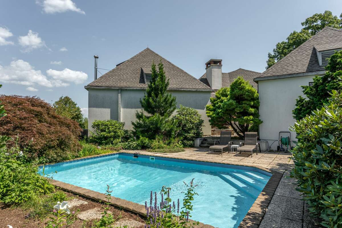 The home on 114 Seherr ThossDrive in Litchfield, Conn. has a pool on its 113-acre property.