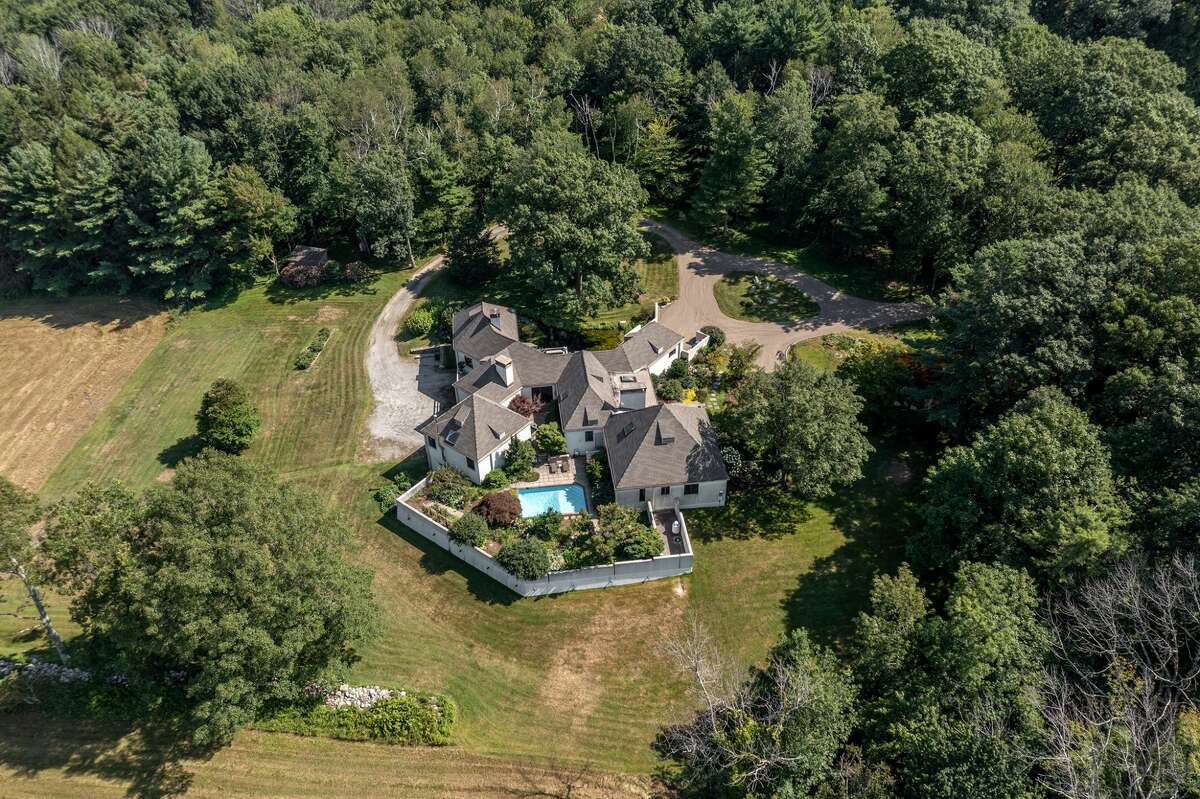 The home on 114 Seherr ThossDrive in Litchfield, Conn. has over 113 acres of land with trails leading to Butternut Brook.