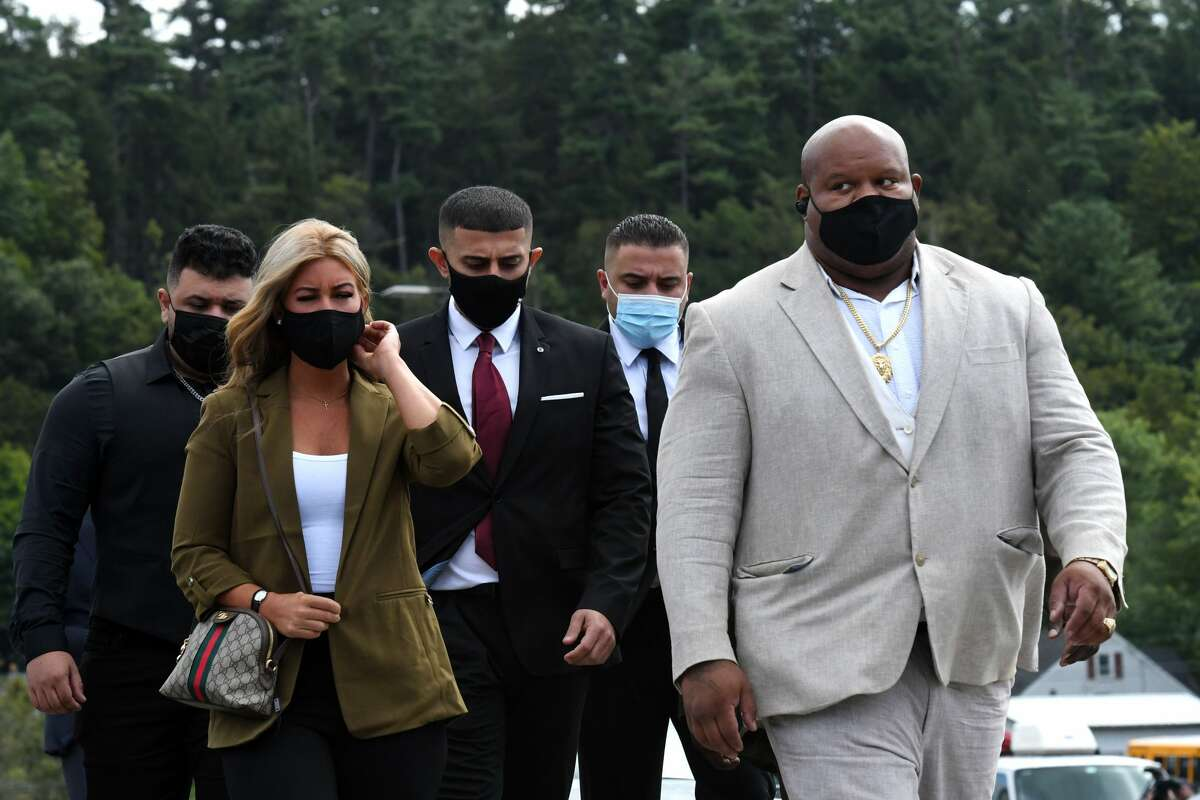 Nauman Hussain, center, operator of the limousine in the deadly 2018 Schoharie limo crash, arrives for a court appearance where he agreed to plead guilty to 20 counts of criminally negligent homicide in exchange for five years of probation and 1,000 hours of community service that will include public speaking appearances on Thursday, Sept. 2, 2021, at Schoharie Central School in Schoharie, N.Y.  (Will Waldron/Times Union)