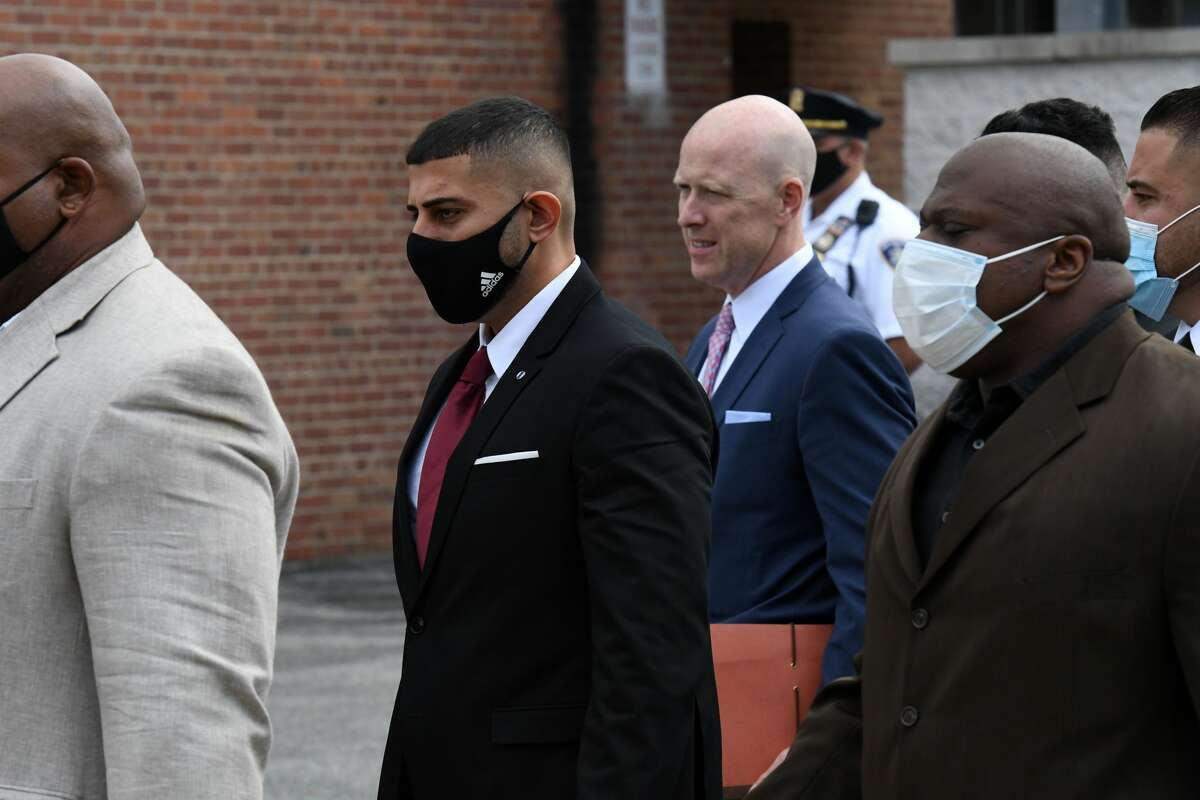 Limousine company operator Nauman Hussain, second from left, arrives at the school building in Schoharie on Sept. 2, 2021 where accepted a plea bargain offer in connection with the deadly Oct. 6, 2018 limo crash that left 20 people dead. Hussain's court appearance was moved to the school because a large crowd of family and friends of the victims were expected to attend Hussain's court appearance.