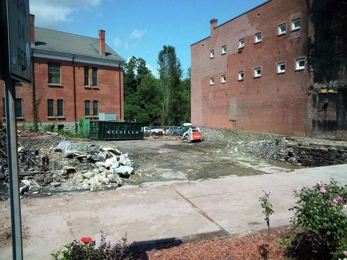 The New Hartford House, which was destroyed in a three-alarm fire Aug. 10, was demolished the following day. The area of the building is fenced in and most of the debris has been removed.