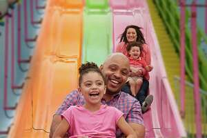A family enjoys the attractions at Washington State Fair in Puyallup.