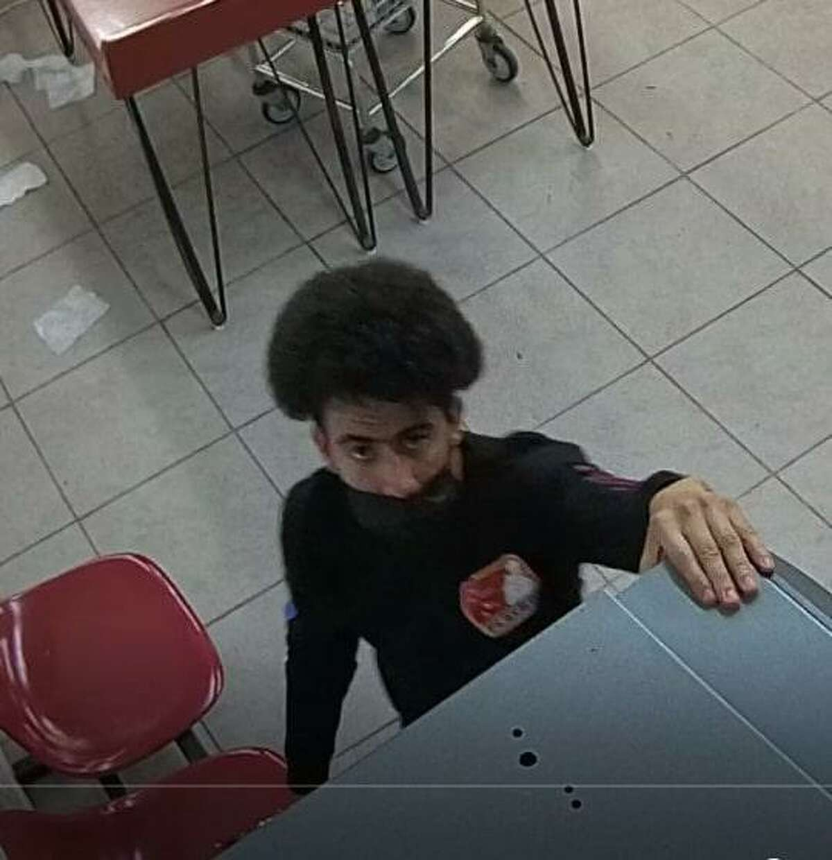Stamford police believe this man caused over $2,000 in damages while trying to break into vending machines inside of a local laundromat.