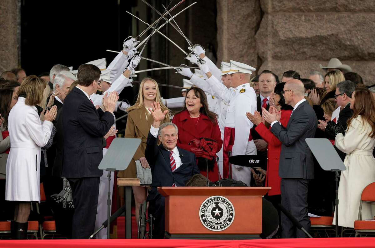 Gov. Greg Abbott arrives with his wife Cecilia and daughter Audrey at the oath of office ceremony on Inauguration Day at the Capitol on Tuesday Jan. 15, 2019. (Jay Janner/Austin American-Statesman/TNS)