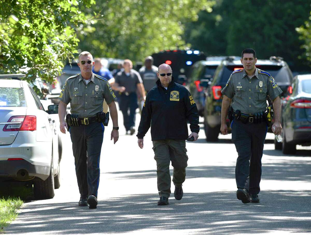 Connecticut State Police and local police and fire units were on River Bend Drive in Woodbury, Conn, after a veteran Connecticut State Police sergeant was killed Thursday after officials say his vehicle was swept away by floodwaters during Ida. Thursday, September 2, 2021.
