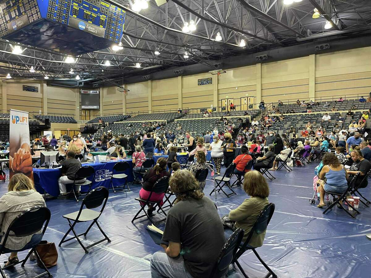 A packed crowd at housing, utility and legal assistance clinic at St. Mary's University Saturday.