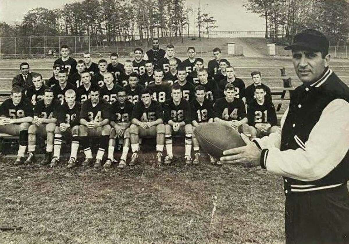 Vito DeVito stands before his MBIAC winning championship team of 1962. DeVito coached in Devon from 1961-72. His 1969 and 1971 teams each went 9-1 and were ranked eighth in the state.