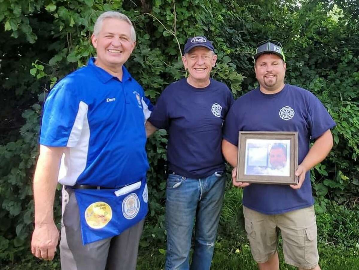 Riverton Volunteer Fire Department Captain Keith Archer was honored recently by Riverton Grange #169 as one of the 2021 Community Citizen Award honorees. From left are Riverton Grange event chair Dave Roberts, Riverton Vol. Fire Chief Norman Bird, and 2021 Honoree Keith Archer.