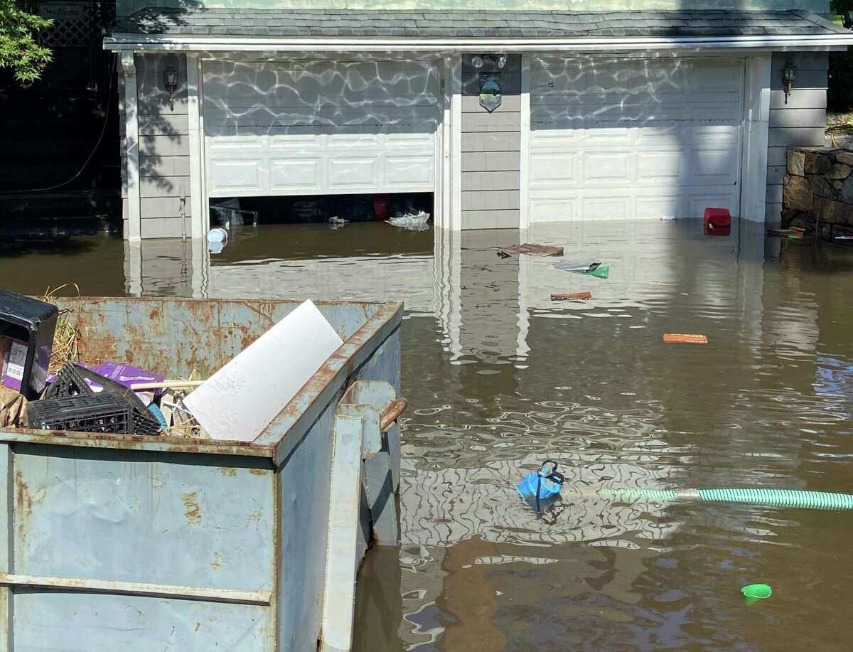 Remnants from Hurricane Ida flooded driveway/garage on Lewis Drive in Farifield on Sept. 2, 2021.