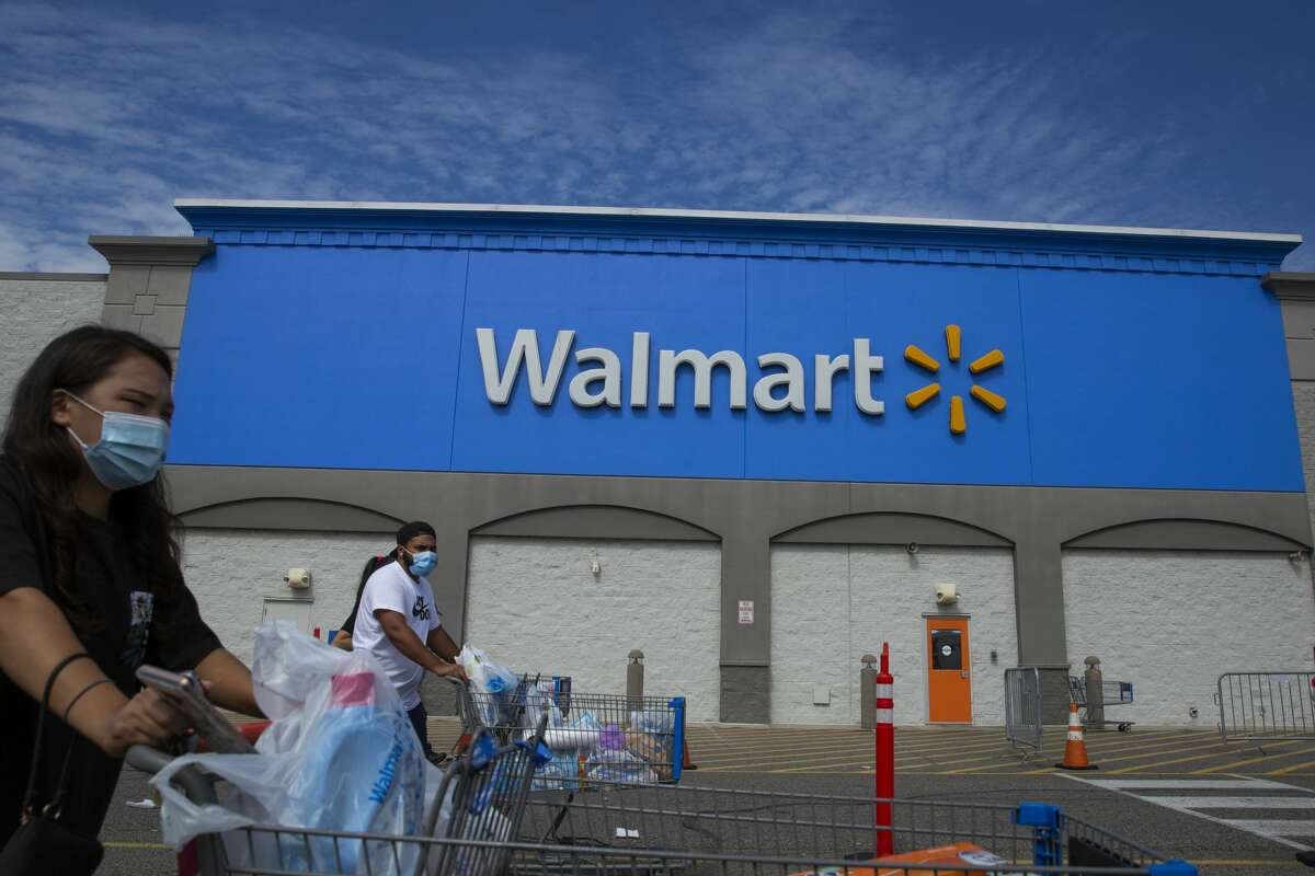 NORTH BERGEN, NJ - AUGUST 23: People past walk by a Walmart store on August 23, 2020 in North Bergen, New Jersey. Walmart saw its profits jump in latest quarter as e-commerce sales surged during the coronavirus pandemic (Photo by Kena Betancur/VIEWpress via Getty Images)