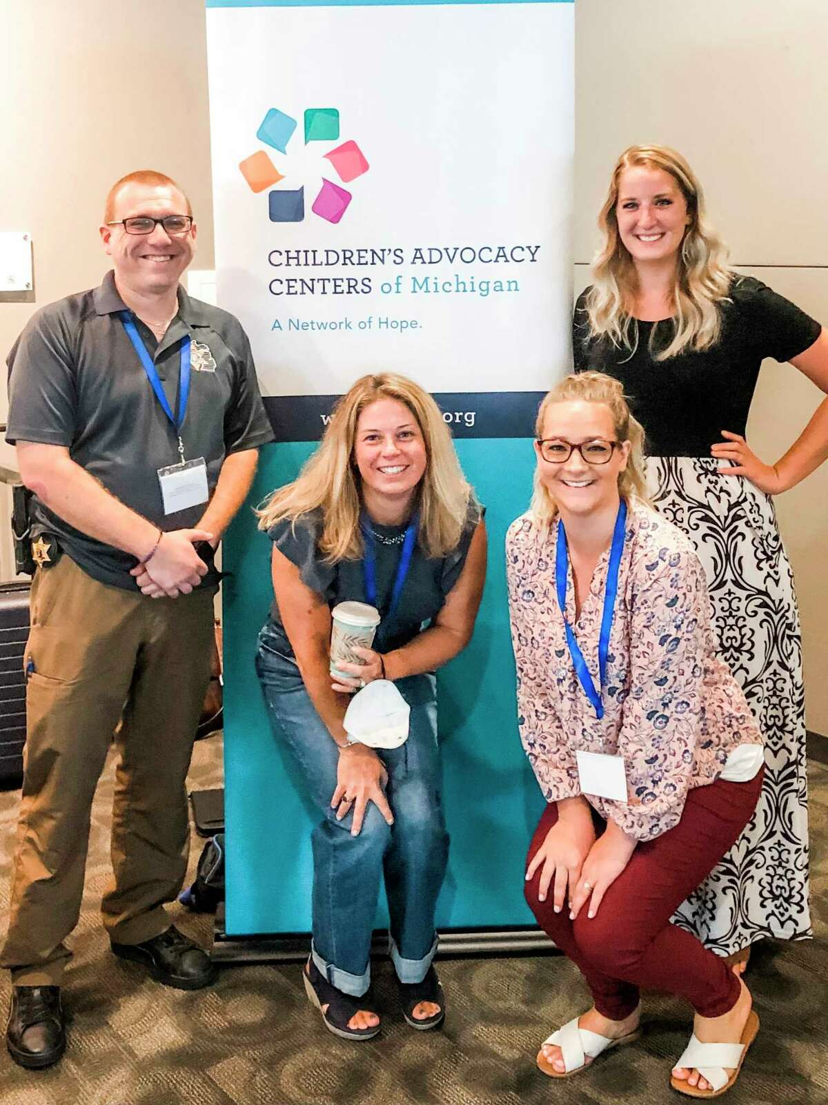 Deputy Alex Schajter, Manistee County Sheriff's Office (left); Christina Thompson, Manistee County Child Advocacy Center forensic interviewer; Chelsea Medacco, MCCAC outreach specialist/advocate; and Kelli Petit, trauma therapist, attended the 11th annual Child AdvocacyConference in Grand Rapids on Monday and Tuesday. (Courtesy photo)