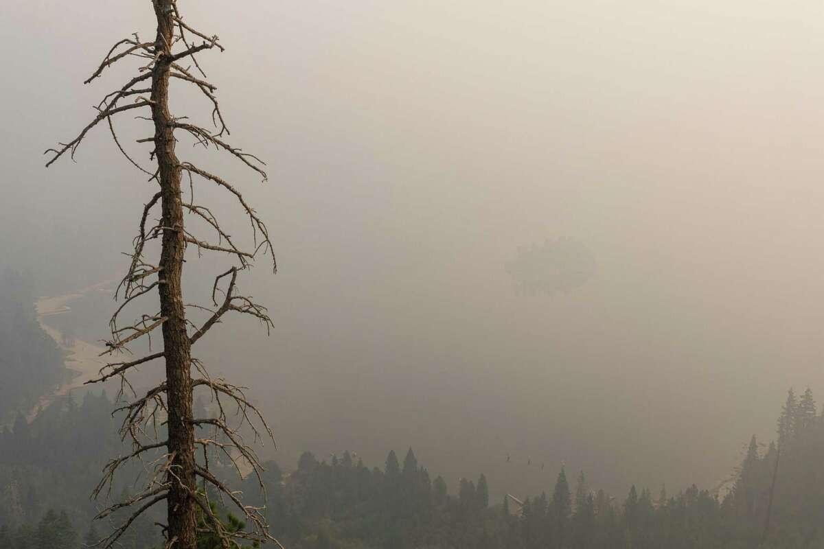 Emerald Bay's Fannette Island on Lake Tahoe is barely due to smoke from the Caldor Fire. Wildfire smoke prompted an air quality advisory in the Bay Area.