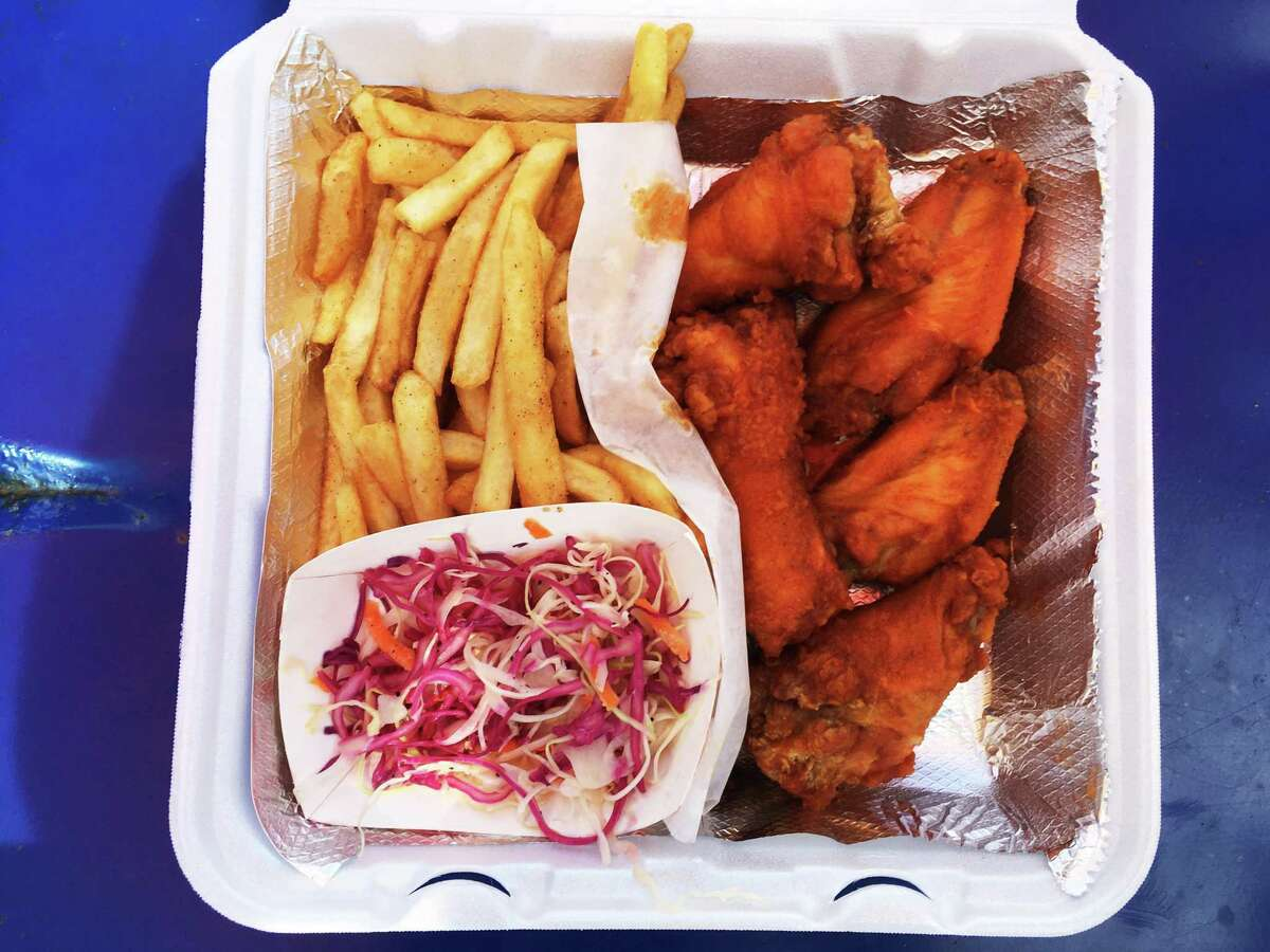 An order of six Buffalo style wings at Slap Chicken