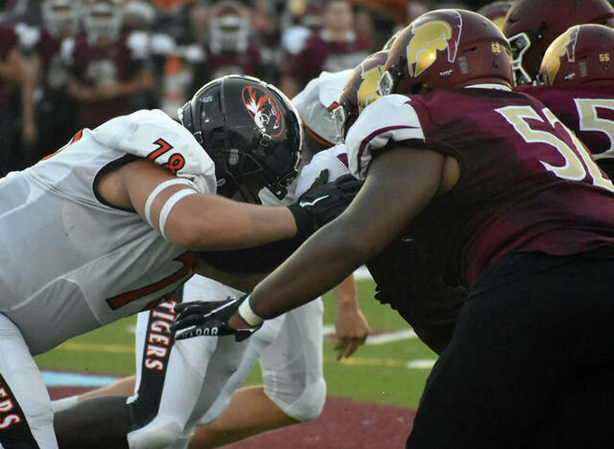 Edwardsville offensive lineman Dawson Rull attempts to block during the first possession of the Week 1 game at De Smet.