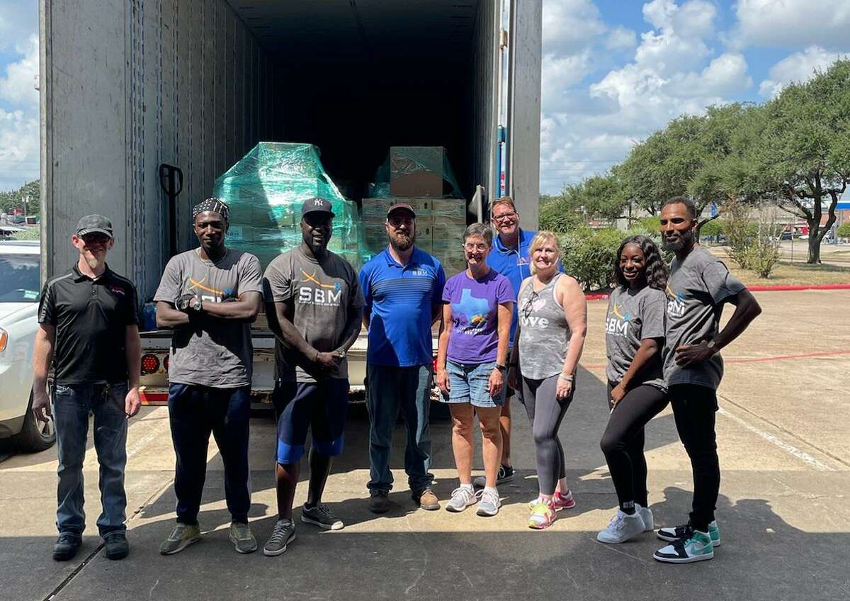 Volunteers pose on Wednesday, Sept. 1, while loading Hurricane Ida relief supplies onto a semitruck headed for LaPlace, Louisiana.