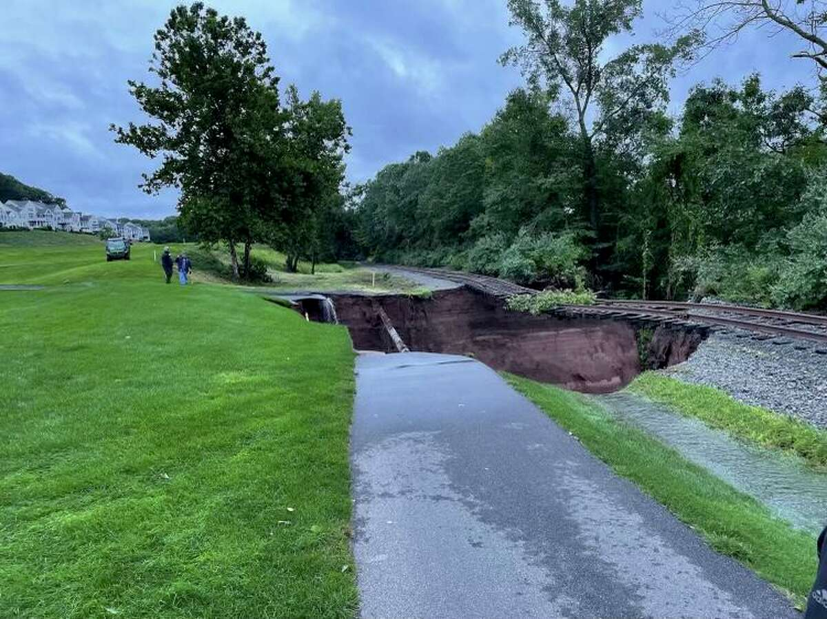 Major rain from Hurricane Ida washed out a cart path at TPC River Highlands in Cromwell and left a gas pipeline and railroad tracks suspended in the air.