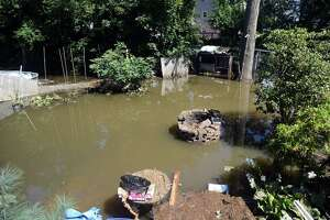 A flooded backyard behind a home on Renwick Place, in Bridgeport, Conn. Sept. 2, 2021. The neighborhood was flooded when heavy rains brought in from the remnants of Hurricane Ida caused flooding along the Rooster River.