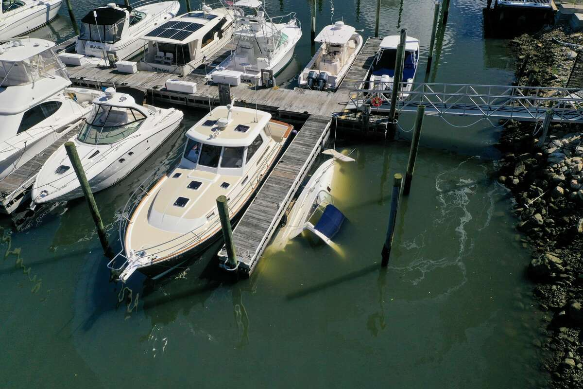 A boat sank at its slip at Norwalk Cover Marina after remnants of Ida hit Connecticut overnight on Thursday, Sept. 2, 2021.