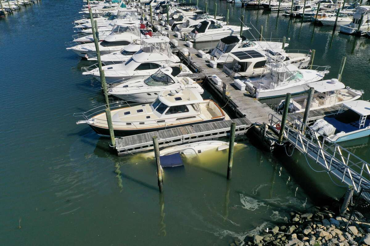 A boat sank at its slip at Norwalk Cover Marinaafter remnants of Ida hit Connecticut overnight on Thursday, Sept. 2, 2021.