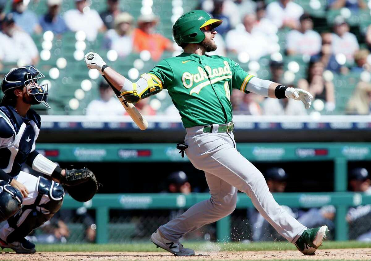 Oakland Athletics' Jed Lowrie (8) watches his three-run home run against the Detroit Tigers during the first inning of a baseball game Thursday, Sept. 2, 2021, in Detroit. (AP Photo/Duane Burleson)