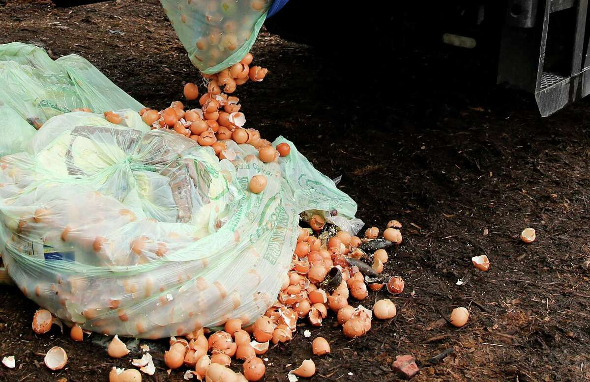 Restaurant food waste collected by Moonshot is dropped off at Nature's Way Resources in Conroe on Wednesday, Aug. 18, 2021. Moonshot, a company that picks up compost from homes and businesses takes their food scraps to Nature's Way Resources.