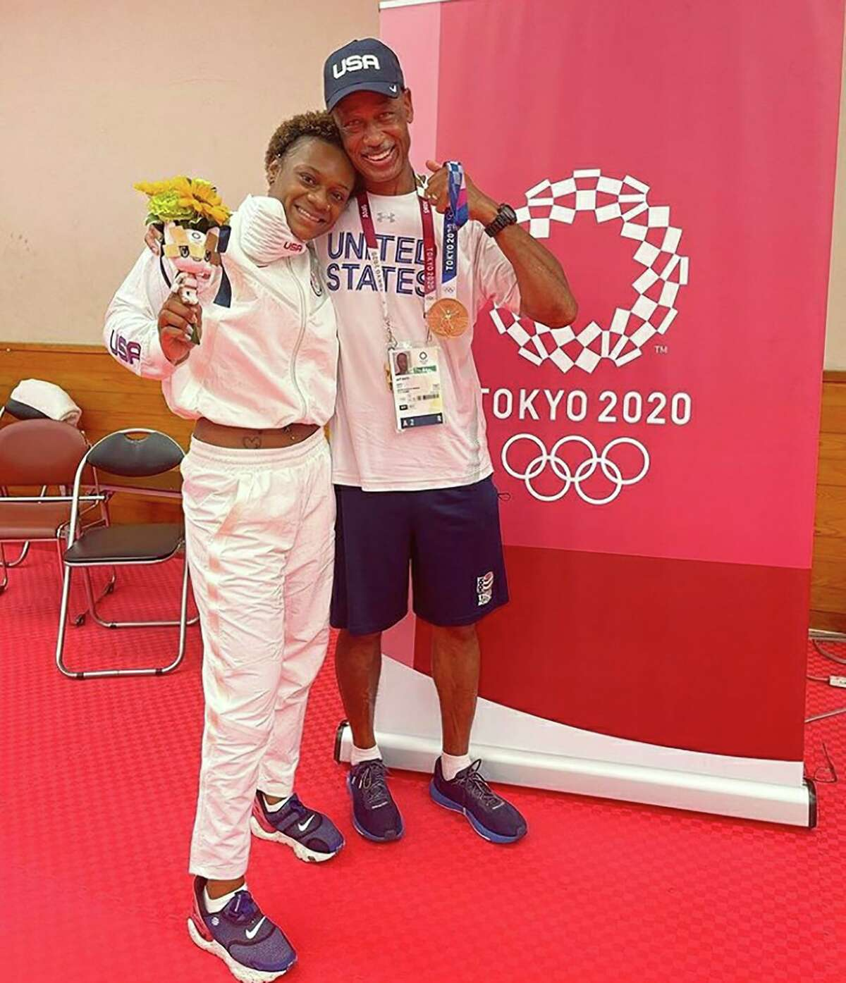 Oshae Jones poses with her bronze medal with San Antonio boxing coach Jeff Mays at a training camp in Miyazaki, Japan. Jones won the bronze medal at the 2020 Tokyo Olympics in the women's 152-pound division.