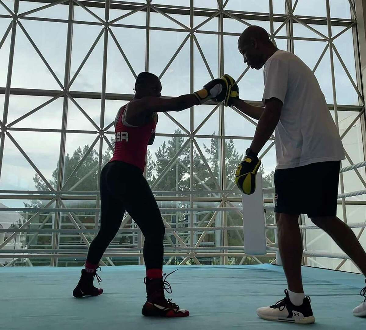 Oshae Jones trains with San Antonio boxing coach Jeff Mays at a training camp in Miyazaki, Japan. Jones won the bronze medal at the 2020 Tokyo Olympics in the women's 152-pound division.
