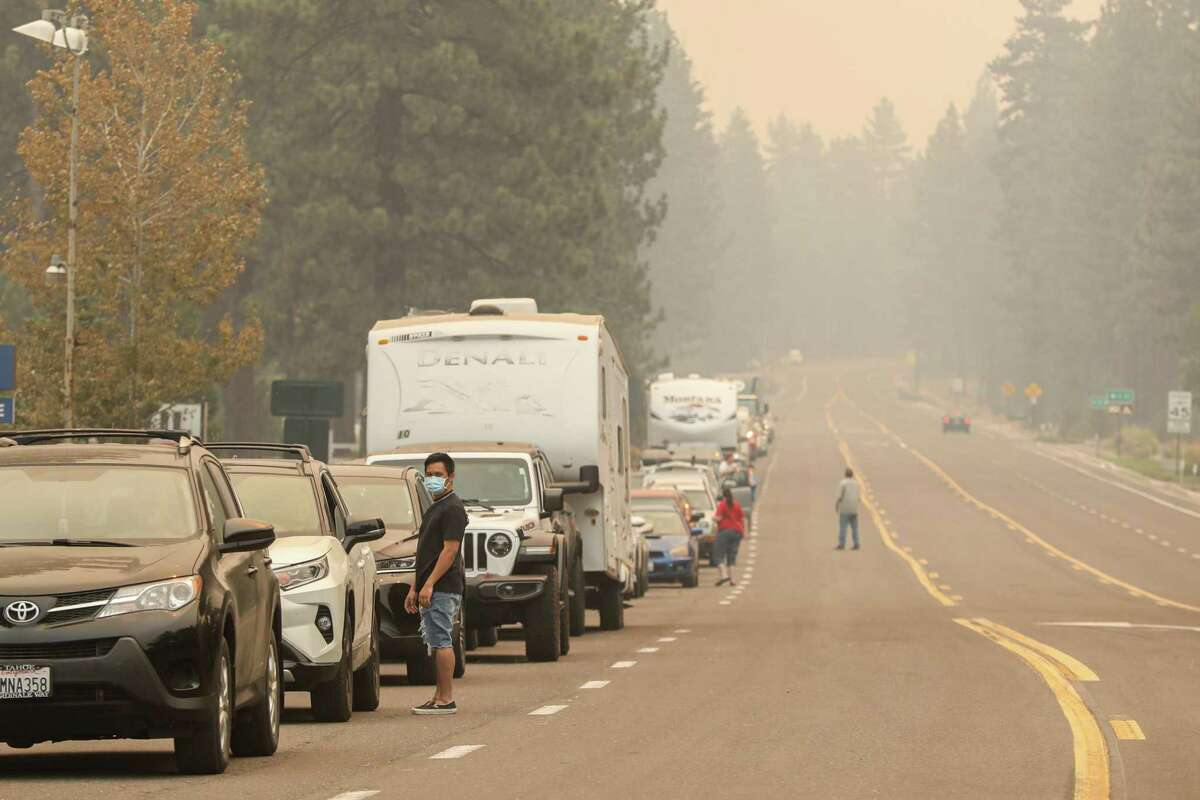 An evacuation line on Highway 50 in South Lake Tahoe, Calif. on Monday, Aug. 30, 2021.