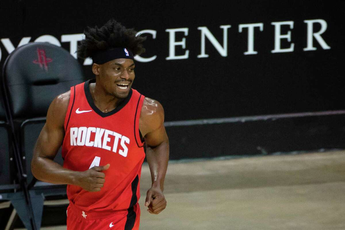 Houston Rockets forward Danuel House Jr. (4) reacts after hitting a three point shot during the first quarter of an NBA game between the Rockets and Timberwolves on Tuesday, April 27, 2021, at Toyota Center.