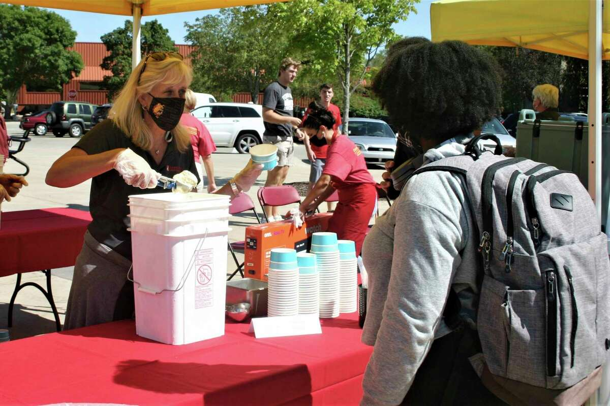 Ferris State University students and staff gathered inRobinson Quad for a resource fair and ice cream social Thursday afternoon. The event was part of the university's annual Founder's Day celebration.(Pioneer photo/Cathie Crew)