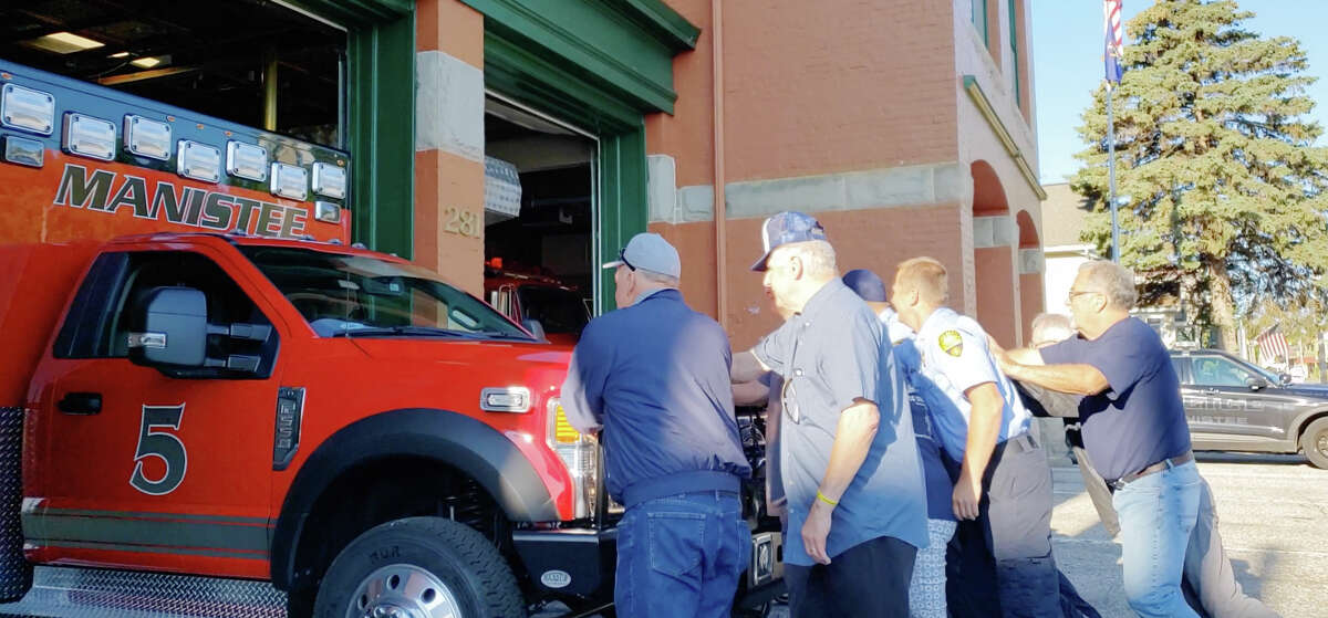 Manistee City Fire Department firefighter-paramedics as well as retired personnel and Manistee City Council members were at the department on First Street helping to push the shining new PL Custom ambulance into its new position on Thursday morning.