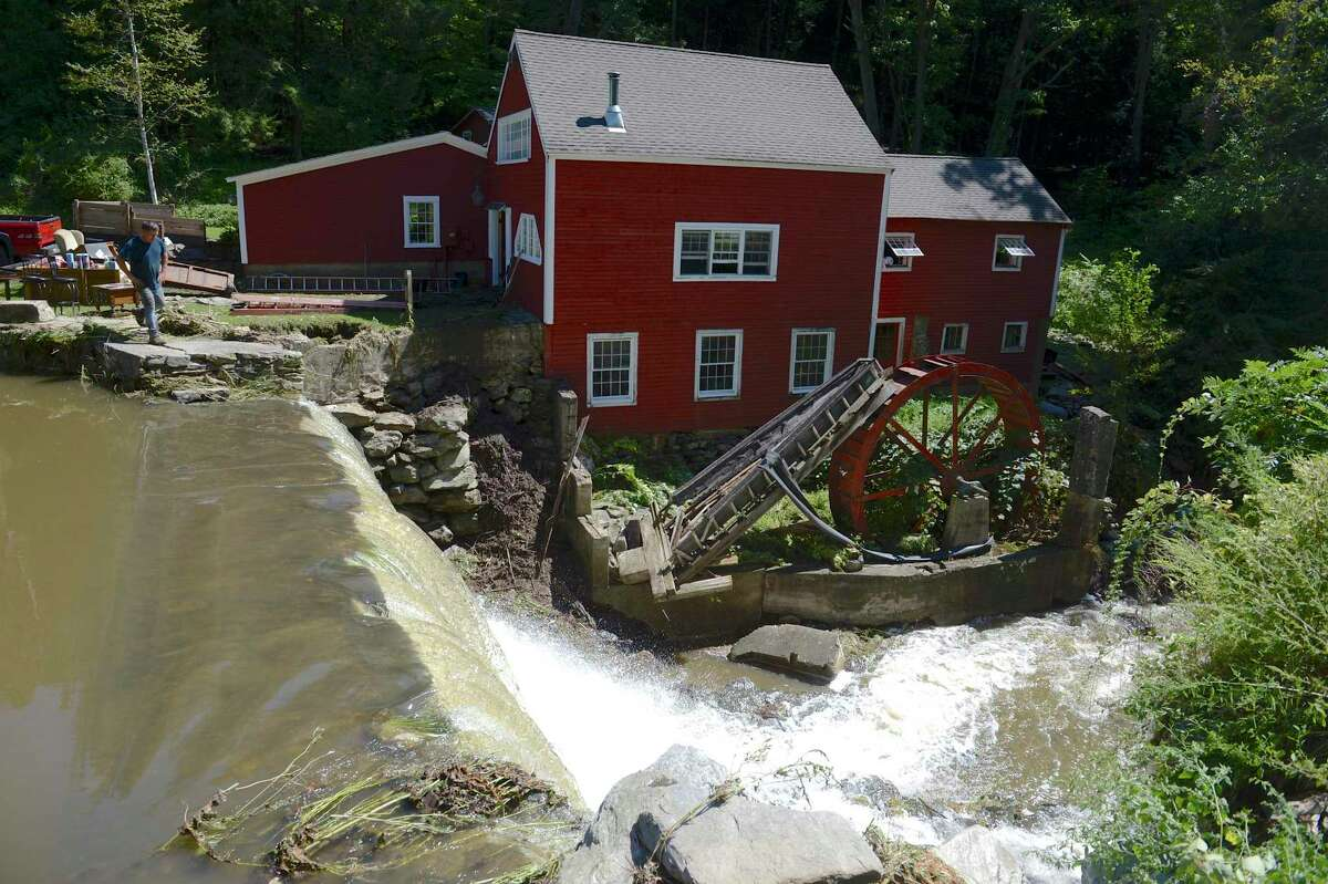 Neighbors helped evacuate an 89-year old woman from a Bridgewater house that experienced severe flooding on Wednesday evening. Thursday, September 2, 2021, Bridgewater, Conn.