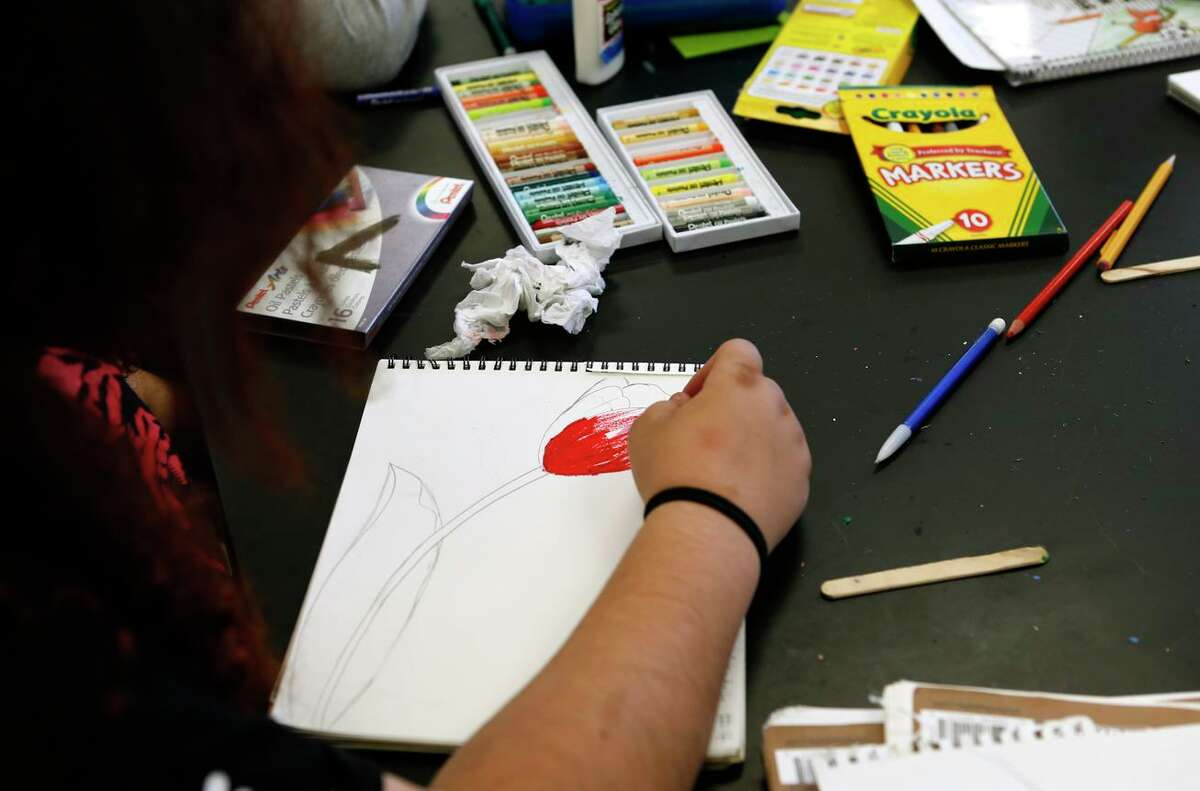 Students work on projects in 7th grade art class at Sequoia Middle School in Pleasant Hill on Sept. 21, 2016. Hundreds of schoolchildren across Mount Diablo Unified School District have switched to an online learning program since school started on Aug. 12, and changes sparked by the exodus are upsetting some families.