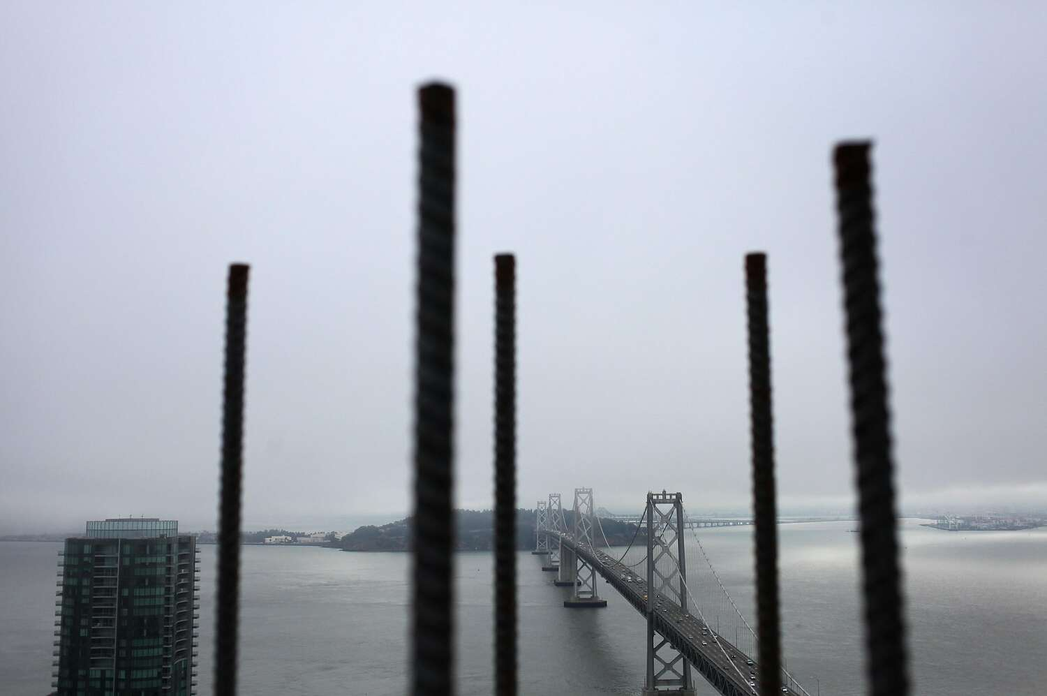 Rebar frames the Bay Bridge as seen from atop One Rincon Hill Phase Two on July 25, 2013