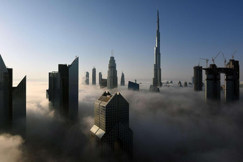 The Burj Khalifa soars over the other towers in Dubai, United Arab Emirates.