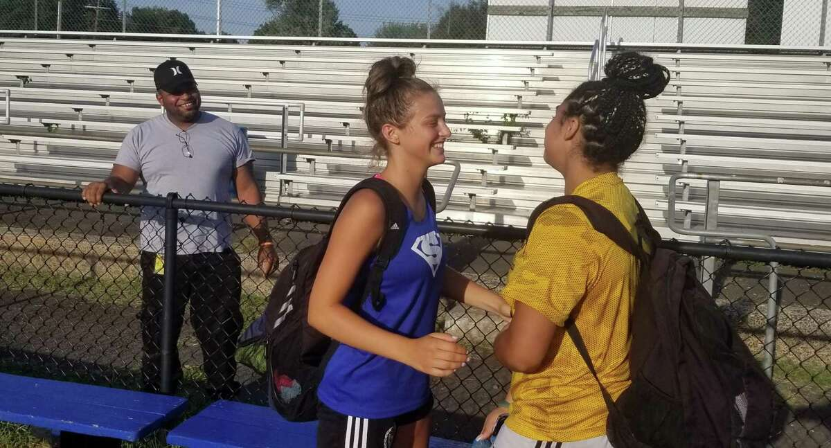 Southington's Jess Carr, left, and Mercy's Melina Ford chat following a preseason scrimmage between the two teams at Southington's Fontana Field on Aug. 31, 2021.