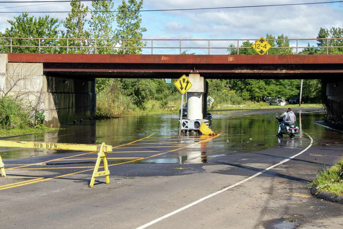 Some motorists try to cross others turn around at the Old Gate Lane underpass on Thursday. Connecticut received about 3 to 6 inches of rain from Hurricane Ida.