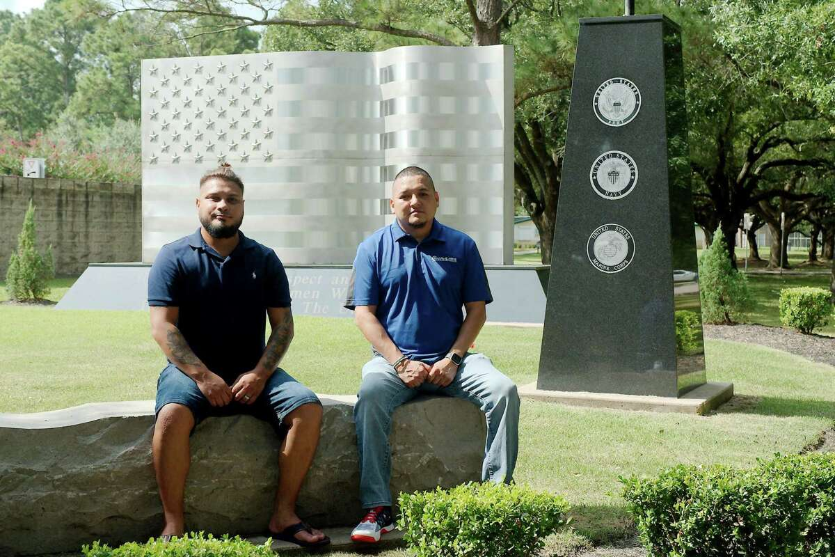 Marine Corps veteran Elias Garcia, left, of Clear Lake and Army veteran Raul Moreno of Pearland say the 9/11 attacks on the United States have had lasting effects on their lives. Behind them is the Veterans Memorial in Friendswood.