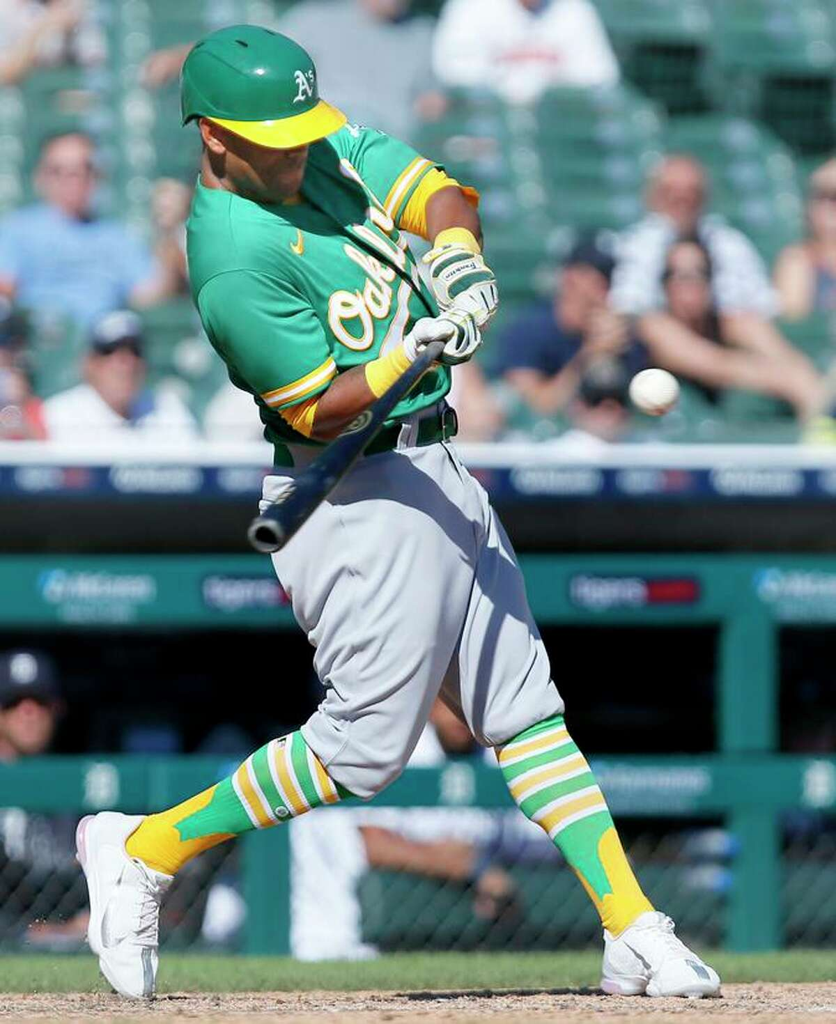 The A's built an early eight-run lead, capped by an RBI double from Khris Davis, and held on for an 8-6 win over Detroit. Davis appeared Thursday as a pinch-hitter for Jed Lowrie.