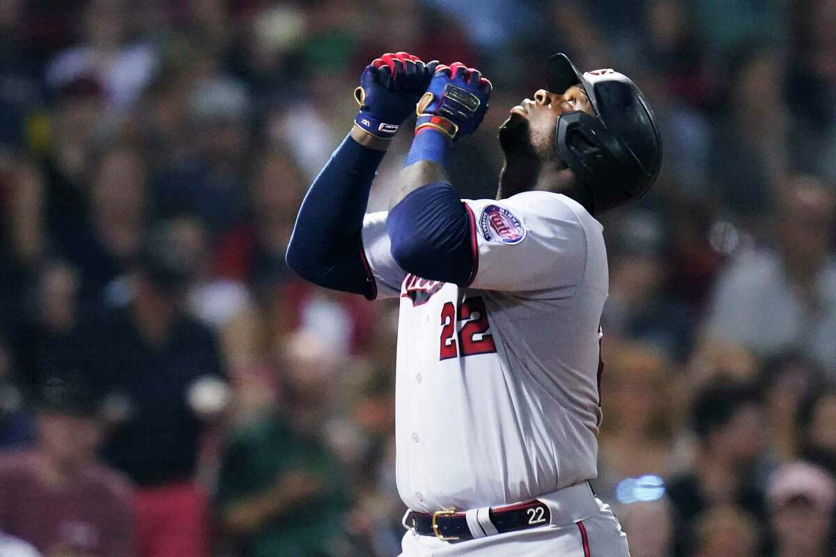 The Twins' Miguel Sano celebrates after hitting a solo home run against the Red Sox on Aug. 25 at Fenway Park in Boston.