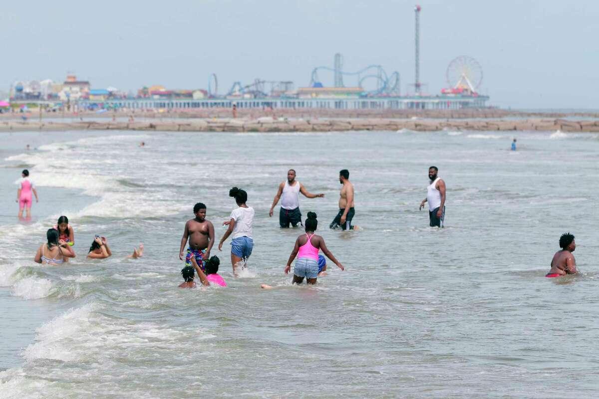 As hurricane Ida reaches Louisiana, beach goers take advantage of calmer conditions near 52nd Street and Seawall Boulevard Sunday, Aug. 29, 2021 in Galveston, TX.