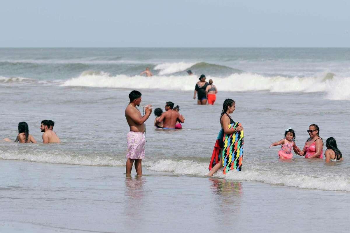 As hurricane Ida reaches Louisiana, beach goers take advantage of calmer conditions near 23rd Street and Seawall Boulevard Sunday, Aug. 29, 2021 in Galveston, TX.